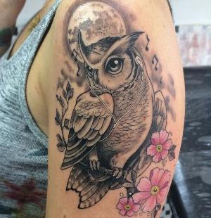tattoo de buhos y flores