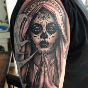 tatuaje de catrina rezando