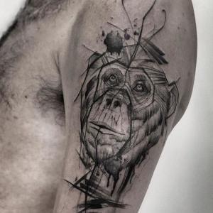 tatuajes de mono en el brazo
