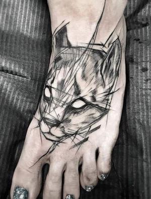 tatuajes bosquejo en el pie