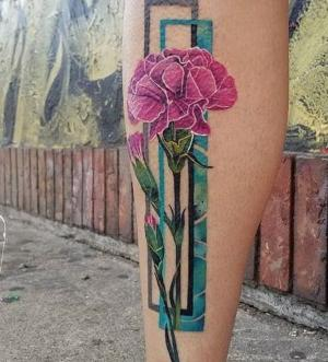 los mejores tatuajes de flores en las piernas