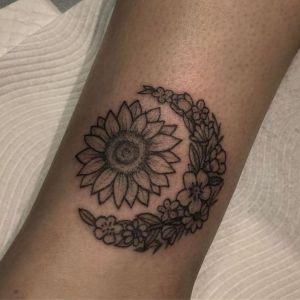 tatuaje sol y luna flores